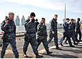 US Navy 100614-N-5483N-206 Sailors walk to the seven yard line marker as they hold a 9mm pistol in the administrative carry position during the Navy Handgun Qualification Course.jpg