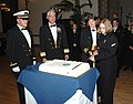 US Navy 101016-N-1993R-006 Rear Adm. Tom Meek, center left, commander of Navy Cyber Forces, watches as Capt. Erika Sauer and Seaman Apprentice Cour.jpg