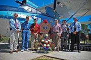 US Navy 110406-N-YR391-008 World War II Navy veterans and their sons pose for a photo during a PBY-5A BUNO 6582 dedication at Naval Air Station Jac.jpg