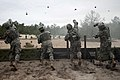 US Navy 110502-N-TH989-078 Sailors toss training grenades during Army Warrior training.jpg