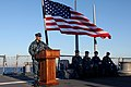 US Navy 110726-N-ZZ999-811 Cmdr. Dennis Velez delivers final remarks to the crew as commanding officer of the guided-missile destroyer USS Fitzgera.jpg