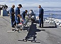 US Navy 111115-N-RI884-254 Sailors aboard the guided-missile destroyer USS O'Kane (DDG 77) load a MK 46 Mod 5A exercise torpedo during the integrat.jpg