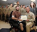US Navy 111206-N-CU929-003 Explosive Ordnance Disposal Technician 2nd Class Andrew Bottrell is presented the Purple Heart medal by Master Chief Lee.jpg