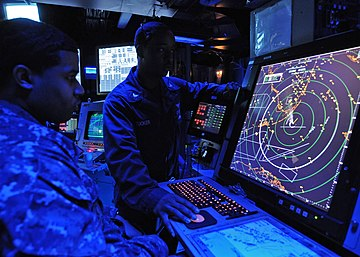 Military air traffic controller on US Navy aircraft carrier monitors aircraft on radar screen US Navy 120208-N-TU894-022 Air-Traffic Controller 2nd Class Gregory Clemmons stands the departure position watch as Air-Traffic Controller 3rd Clas.jpg