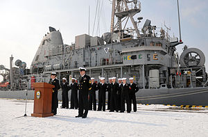US Navy 120214-N-MU720-003 Lt. Cmdr. Suzanne Schang, commanding officer of the mine countermeasures ship USS Patriot (MCM 7), prepares to address m.jpg