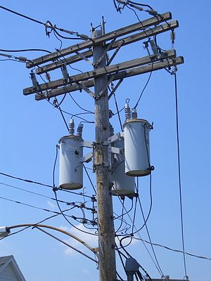 "Distribution transformer - A ""transformer bank"", widely used in North America: three single-phase transformers connected to make a 3-phase transformer."