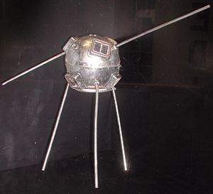 Project Vanguard -  Vanguard TV3 in previous display at the National Air and Space Museum.  The antenna rods should extend radially from the body of the satellite, but are bent as a result of damage sustained in the launch failure.