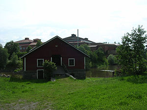 Loimaa - Mill of Vesikoski in the shores of river Loimijoki. Visible in the background are old industrial buildings.