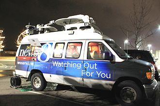 WOOD-TV - 24 Hour News 8 remote van.