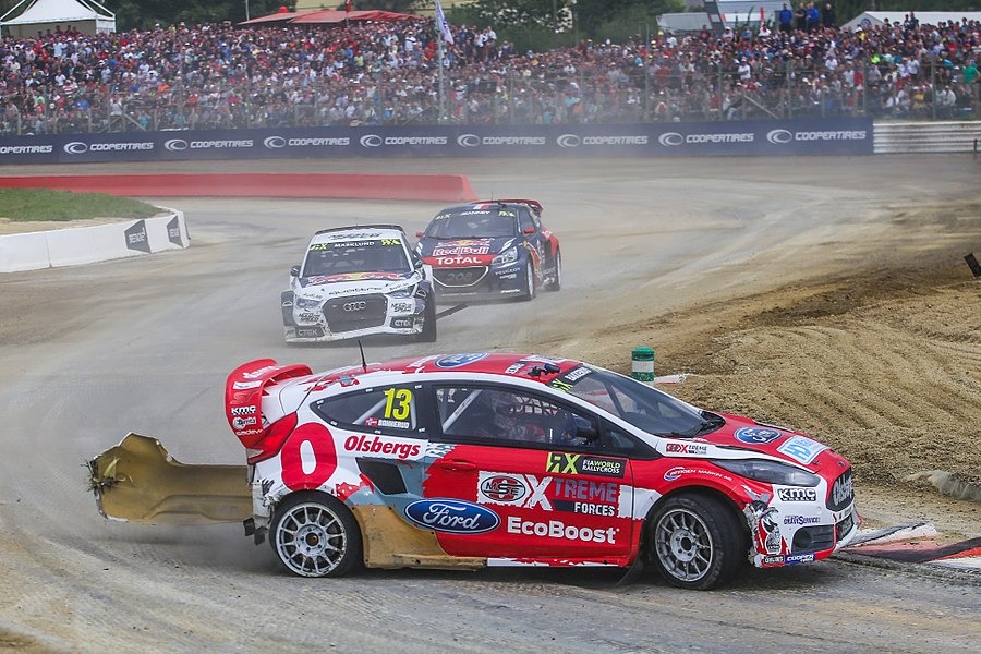 Andreas Bakkerud (Ford) leads Anton Marklund (Audi) and Davy Jeanney (Peugeot) in semi-final #1 at Round 9 of the 2015 FIA World Rallycross Championship at Circuit de Lohéac, France.