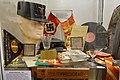 WW2 in Norway. Uniform cap, armlets, badges, necktie, emblems, propaganda pamflets, NS-marsjen, stamps, Hirden pennant, Quisling door sign, glass, etc. of NS (Nasjonal Samling Nazi party). Lofoten krigsminnemuseum 19-05-08 A.jpg
