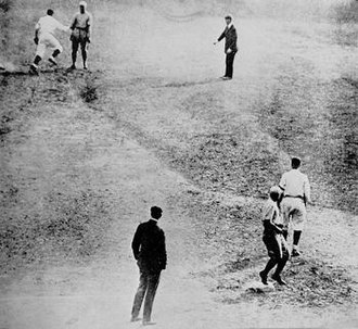 1920 World Series - Bill Wambsganss (upper left) completing his unassisted triple play in Game 5, about to tag a stunned Otto Miller after touching second to double up Pete Kilduff (right foreground, touching third).