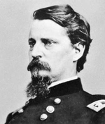 Photo of dark-haired and bearded Winfield S. Hancock in a dark uniform with a determined look