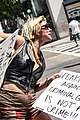 Woman Holding Her Sign Walking In the March (9639301395).jpg