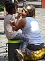 Woman and Child in Market - Sofia - Bulgaria (42829746462).jpg