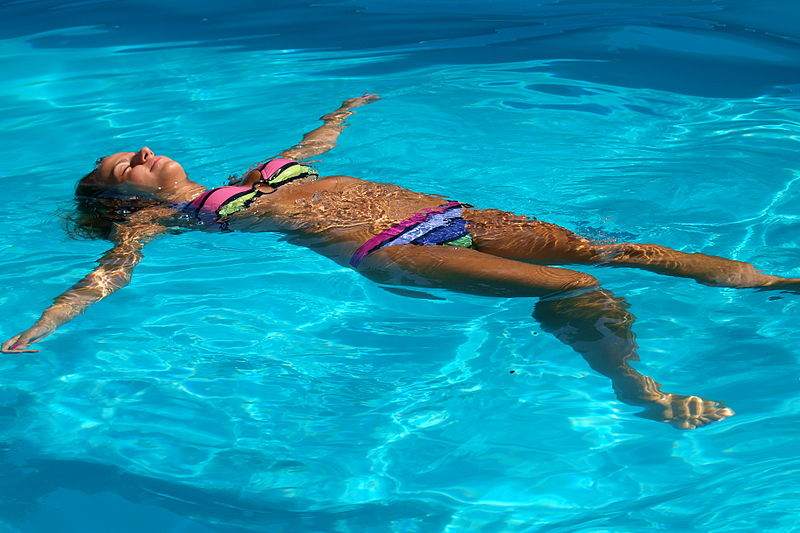 File:Woman enjoys a swimming pool.JPG