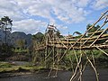 Wooden footbridge in Vang Vieng and blue sky.jpg