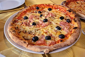 Woodfire pizza in restaurant in Bologna, Italy.jpg