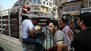 Wounded civilians arrive at hospital Aleppo.jpg