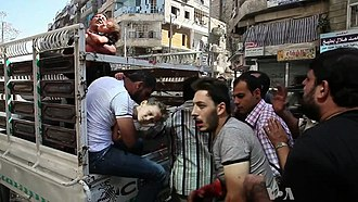 Syrian Civil War - Wounded civilians arrive at a hospital in Aleppo, October 2012