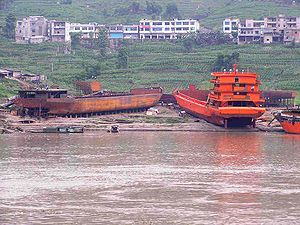 A shipyard on the banks of the Yangtze building commercial river freight boats