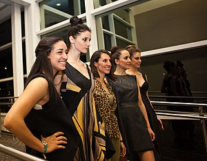 ebc30142 Women wearing formal outfits at a 2015 fashion show.