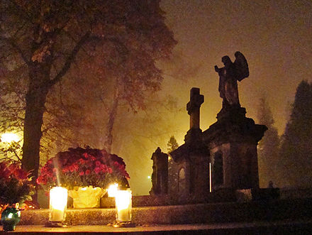All Saints' Day at a cemetery in Sanok - flowers and lit candles are placed to honor the memory of deceased relatives. Poland, 1 November 2011 01259 All Saints Day Sanok, 2011.jpg