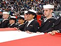 050116-N-4729H-146 Sailors from Naval Air Station Joint Reserve Base Willow Grove, Pa. hold a giant American flag in a National Football League pregame ceremony in Philadelphia between the Philadelphia Eagles and Minnes.jpg