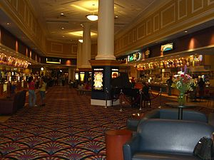 National Amusements - The City Center 15 Cinema De Lux in White Plains, New York's City Center includes a waiting area with a TV, newspaper rack and sofas (left), a piano (center), and a bar and grill restaurant (not pictured).