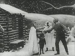 ed08b178 Stillbilde fra Edwin S. Porters 1903-versjon av Onkel Toms hytte, som var  en av de første filmene i full lengde. Stillbildet viser Eliza som  forteller Onkel ...