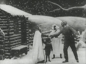 "Tom show - Still from Edwin S. Porter's 1903 version of Uncle Tom's Cabin, which was one of the first ""full length"" movies. The still shows Eliza telling Uncle Tom that she has been sold and that she is running away to save her child."