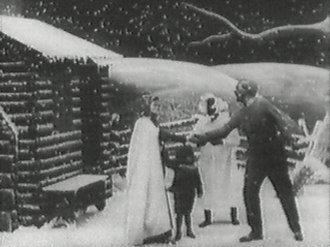 """Tom show - Still from Edwin S. Porter's 1903 version of Uncle Tom's Cabin, which was one of the first """"full length"""" movies. The still shows Eliza telling Uncle Tom that she has been sold and that she is running away to save her child."""