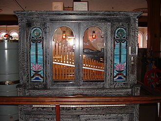 "Orchestrion - 1918 Seeburg Orchestrion, ""Style G"", located at Clark's Trading Post in Lincoln, New Hampshire. Uses a 10-song music roll and plays multiple wind, string, and percussion instruments."