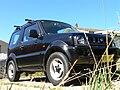 1999 Suzuki Jimny (SN413 Type1) SLX hardtop (2006-02-07) 01.jpg