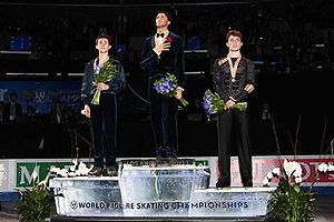 2009 World Figure Skating Championships - The men's podium. From left: Patrick Chan (2nd), Evan Lysacek (1st), Brian Joubert (3rd).