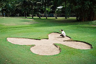 Hazard (golf) - The butterfly greenside bunker on the 9th hole at Dunk Island Golf Course