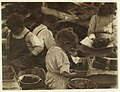 3 year old girl and 2 boys hulling berries at Johnson's Canning Camp, Seaford, Del. LOC nclc.00791.jpg