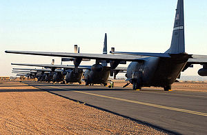 485th Air Expeditionary Wing - A row of C-130 Hercules from the 485th Air Expeditionary Wing are parked at a forward-deployed location in Southwest Asia. Seven C-130 units combined to form the world's largest collection of the aircraft.