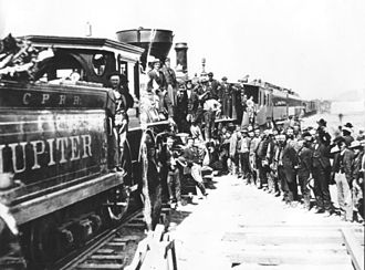 Jupiter (locomotive) - Celebration of completion of the Transcontinental Railroad, May 10, 1869, showing the name Jupiter on the side of the tender