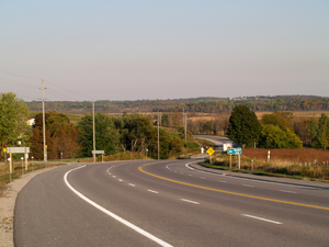 Ontario Highway 7A - A reverse curve east of Port Perry. The Osler Marsh, a southern extension of Lake Scugog, is visible in the distance.