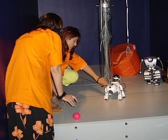 Ars Electronica Center - Members of the center staff demonstrate some entertainment robots.