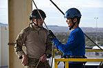 A 58th Rescue Squadron combat rescue officer provides guidance to Zachery Oberg.jpg
