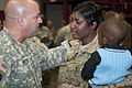 A South Carolina Army National Guardsman with the 3-49th Agribusiness Development Team comforts a fellow Soldier during a departure ceremony for family and friends at the McCrady Training Center in Eastover 130110-Z-HU793-003.jpg