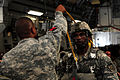 A U.S. Army paratrooper with the 1st Brigade Combat Team, 82nd Airborne Division inspects another paratrooper on an Air Force C-17 Globemaster III aircraft June 27, 2013, during Joint Operational Access Exercise 130627-F-GO452-279.jpg