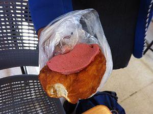 Vetkoek - A vetkoek topped with meat