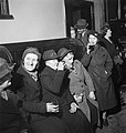 A group of women enjoy a drink and share a joke at the Wynnstay Arms, Ruabon, Benbighshire, Wales, 1944. D18499.jpg