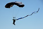 A member of the U.S. Air Force Wings of Blue parachute team descends toward Sheppard Air Force Base (29859578961).jpg