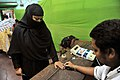 A polling official administering indelible ink to a voter, at a polling booth, during the fifth phase of West Bengal Assembly Election, at Khidirpu, West Bengal on April 30, 2016.jpg