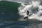 A surfer under wave.jpg