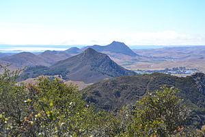 Bishop Peak (California) - Image: A view of several of the Nine sisters towards Morro Rock from Bishop Peak